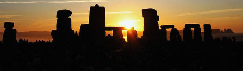"""Summer Solstice Sunrise over Stonehenge 2005"". Licensed under CC BY-SA 2.0 via Commons - https://commons.wikimedia.org/wiki/File:Summer_Solstice_Sunrise_over_Stonehenge_2005.jpg#/media/File:Summer_Solstice_Sunrise_over_Stonehenge_2005.jpg"