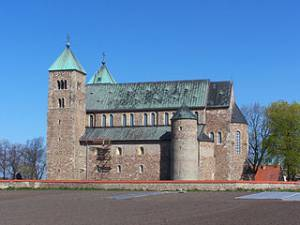 """Romanesque Collegiate Church in Tum"" by Jan Mehlich, shared under Creative Commons - https://en.wikipedia.org/w/index.php?title=Collegiate_Church_of_St._Mary_and_St._Alexius,_Tum&previous=yes#/media/File:Tum_-_Kolegiata_01.jpg"